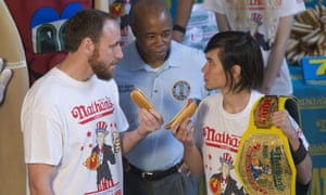 Matt Stonie, right, reigning hot dog-eating champion, stares down eight-time champion Joey Chestnut during the official weigh in for Nathans Famous hot dog eating contest on Friday.