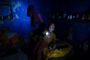Who's There (Varanasi, India. 2014). In the midst of a power cut, an elderly woman searches for her medicines in her small room in an old people's home in Varanasi