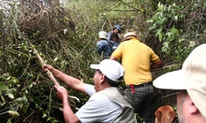 Bolaños residents clear vegetation as part of the 'minga'.
