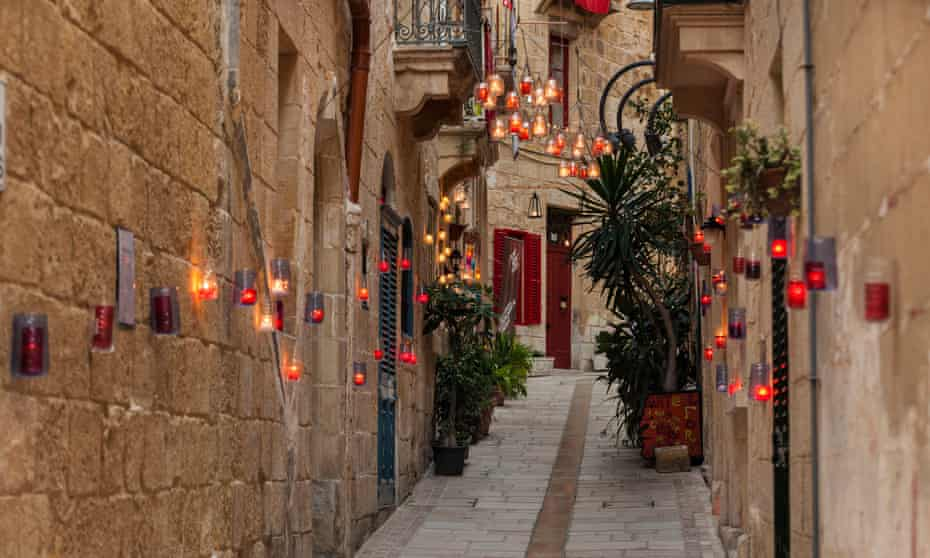 BirguFest shows the old city by candlelight.