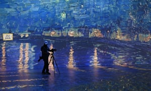 People attend the Beyond Van Gogh exhibit in Florida, which immerses the viewer on a journey through over 300 iconic artworks