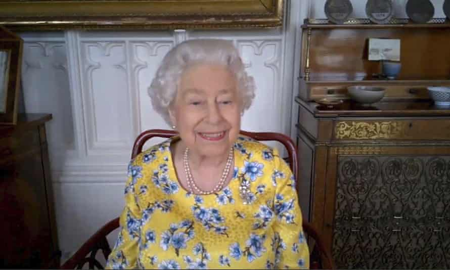 The Queen, during a videolink call to the Foreign and Commonwealth Office, watching the official unveiling of a new portrait of herself by artist Miriam Escofet.
