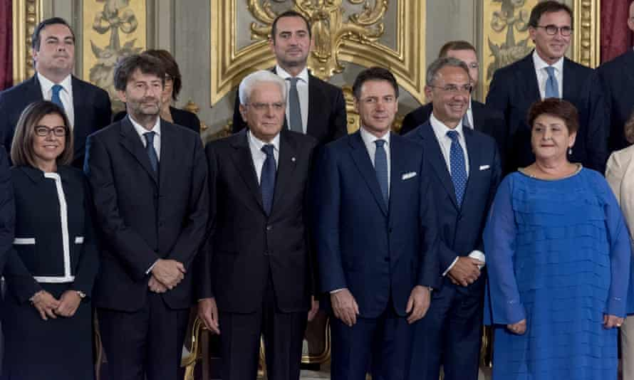 Italy's president, Sergio Mattarella, and Conte (both centre) pose with members of the new cabinet