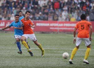 Players from Simorgh Alborz and Toofaan Harirod fight for the ball during the 2012 final.