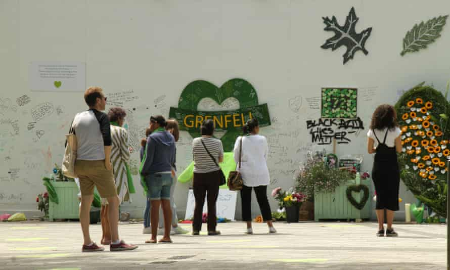 Members of the public pay their respects during the third anniversary of the Grenfell Tower disaster, which killed 72 people.