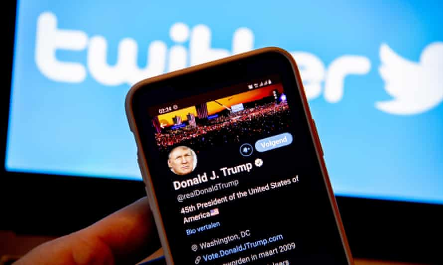 Twitter logo and smartphone showing Donald Trump's account