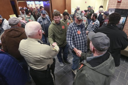 Spectators file out of a packed Buckingham county board of supervisors meeting after the board unanimously voted to pass a second amendment sanctuary city resolution in Buckingham, Virginia.