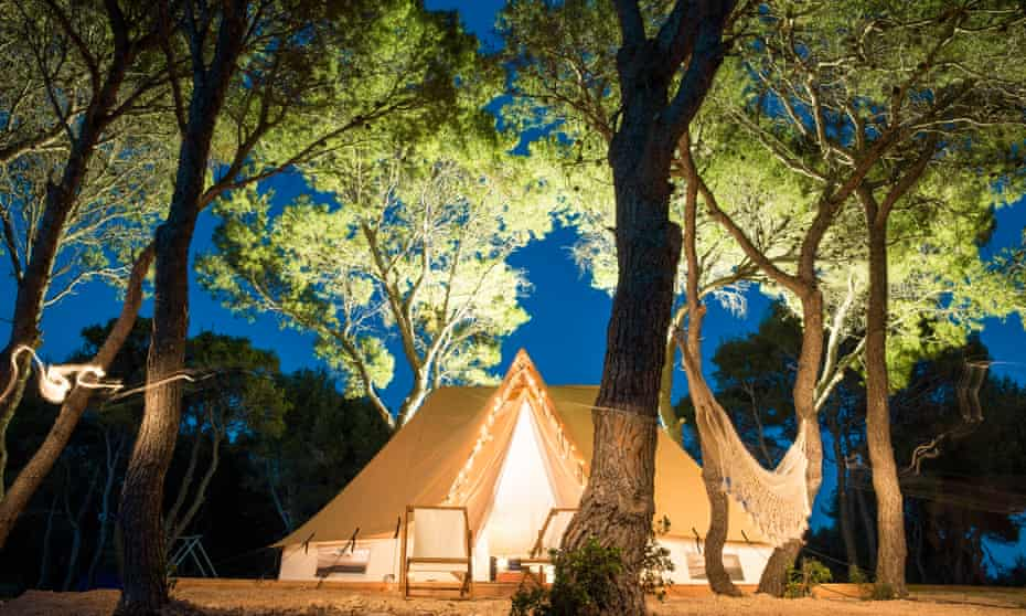 Bell tent accommodation in the trees at night.