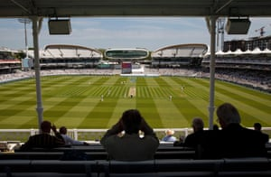 Members watch from the pavilion towards the new Compton and Edrich Stands either side of the Media Centre.