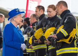 London, UK: The Queen meets firefighters during a visit to the Westway sports centre, which is providing temporary shelter for people left homeless by the Grenfell Tower fire