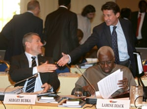Sebastian Coe greets fellow Olympian Sergey Bubka, with his then boss Lamine Diack sitting in front, at an IAAF meeting in Monaco in 2009.