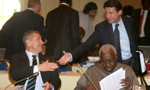 Coe shaking hands with Sergei Bubka, whom he beat in the 2015 IAAF presidential election.