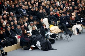 People wounded in the Paris attacks and family members attend a ceremony to pay a national homage to the victims of the Paris attacks