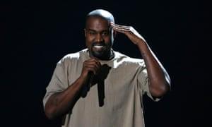 Kanye West saluting.