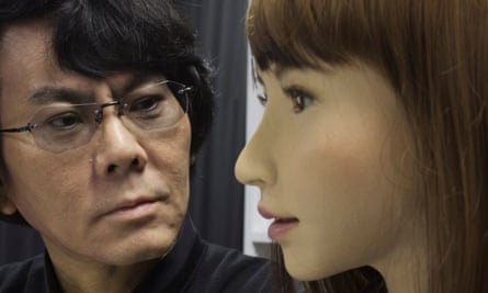 Hiroshi Ishiguro, a professor at Osaka University's Intelligent Robotics Laboratory, with Erica, his latest humanoid robot.