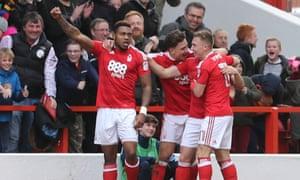 Britt Assombalonga, left, celebrates scoring his controversial opener for Nottingham Forest during their 3-0 win over Brighton.