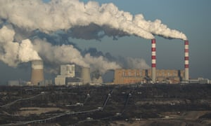 Steam and smoke rise from a coal-fired power station in Poland