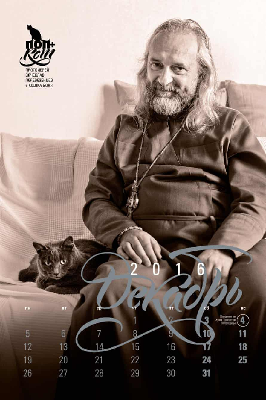 An Orthodox priest poses with his cat for glossy calendar.