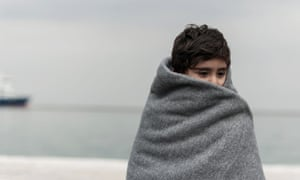 A child is among migrants and refugees arriving on the Greek island of Lesbos after crossing the Aegean from Turkey this month.