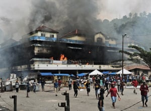 Local market is seen burning during a protest in Fakfak, West Papua province, Wednesday, Aug. 21, 2019.