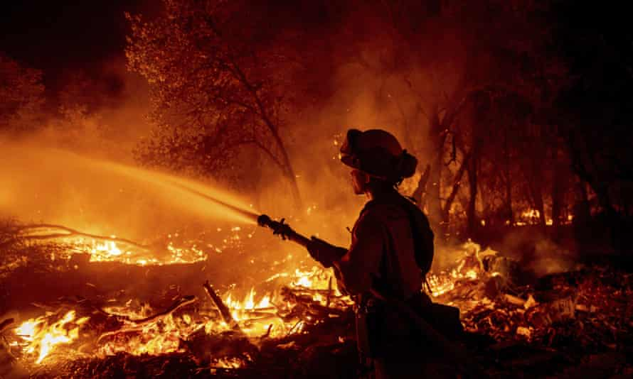 A firefighter battles the Fawn fire in Shasta county on 23 September.