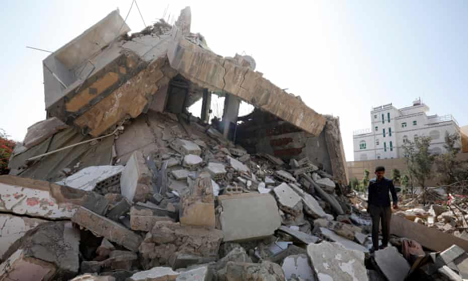 A Yemeni walks through the debris of a destroyed building in Sana'a, Yemen.