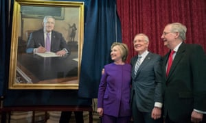 Former secretary of state Hillary Clinton stands beside Senate minority leader Harry Reid and majority leader Mitch McConnell at the unveiling of a portrait of Reid, on Capitol Hill.