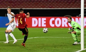 Spain's defender Jose Luis Gaya Pena tuns the ball home for Spain's equaliser.