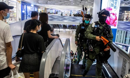 Hong Kong riot police attend a protest inside a mall at Yuen Long i