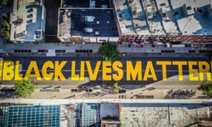A mural covers a street in Brooklyn, New York during protests against racism in the city in June.