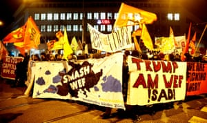 Protesters carrying banners during a demonstration against U.S. President Trump in Zurich last night