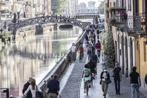 People walk along the popular Navigli area in Milan on Friday.
