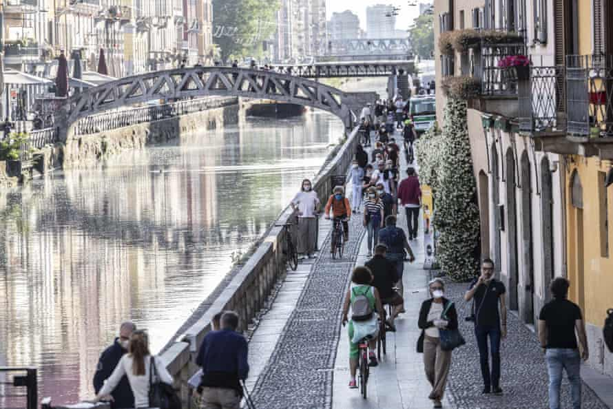 People walk along the Navigli area in Milan on Friday.