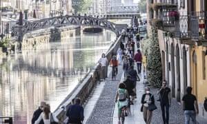 People walk along the popular Navigli area, in Milan, Italy on Friday.