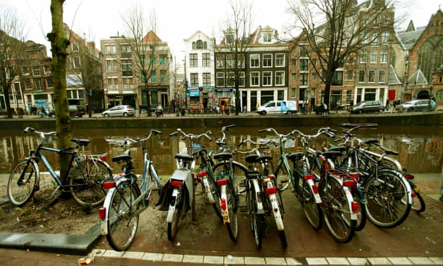 Bicycles parked by a canal in Amsterdam