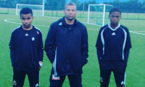 A young Leon Bailey (left) with his stepdad Craig Butler and brother Kyle.