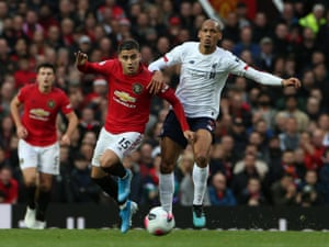 Andreas Pereira of Manchester United gets the better of Liverpool's Fabinho.