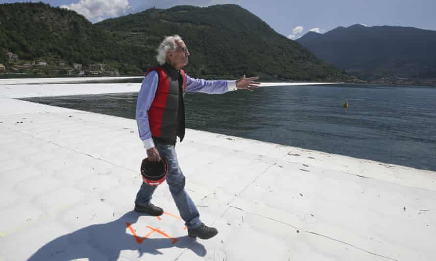 Christo walks The Floating Piers on the Lake Iseo in northern Italy.