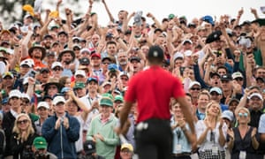 Supporters cheer as Tiger Woods claims victory at the 2019 Masters.