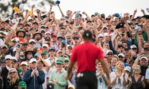 Tiger Woods's victory was greeted by pandemonium in the crowds, was followed by Augusta's traditional, muted Green Jacket ceremony in Butler Cabin.
