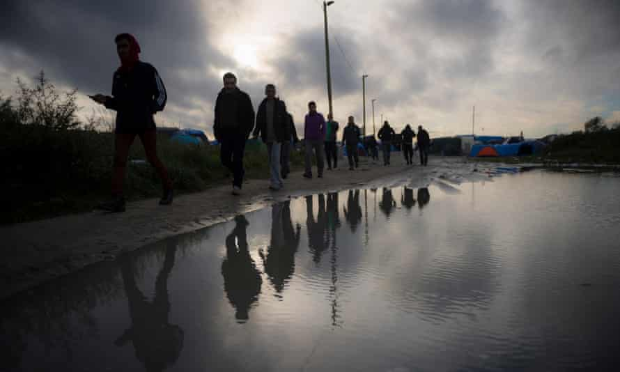 Refugees at the so-called 'Jungle' migrants camp in Calais