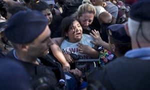A youth cries amid scuffles between migrants and Croatian police officers in Tovarnik, Croatia