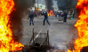 South African police fire rubber bullets at people in Masiphumelele, Cape Town