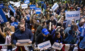 Supporters cheer Bernie Sanders following a rally at the Arthur Ashe Junior Athletic Center on Thursday in Richmond.
