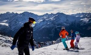 Skiers wearing face masks in Verbier in November.