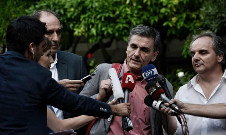 Greek finance minister Euclides Tsakalotos talks with reporters.