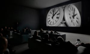 An audience watching The Clock.