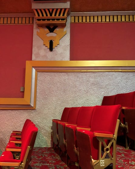 Picture of a wall of the Regent with the art deco decorative features picked out in gold