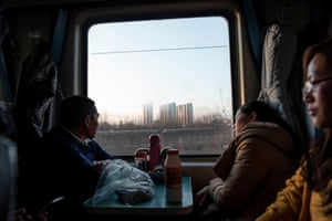 Passengers sit on a crowded train as it leaves Beijing for the 26-hour journey to Chengdu ahead of the lunar new year.