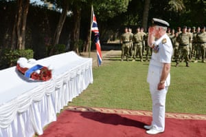 The Prince of Wales lays a wreath during an Armistice Day service at the British Embassy in Manama, Bahrain